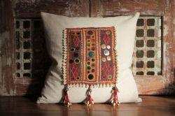 Cushion with antique tribal textile and French linen